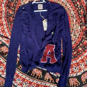 """One of a kind """"A"""" patch cardigan with design tears"""